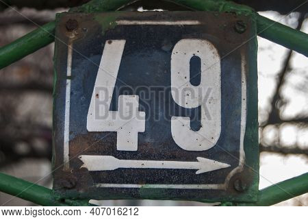 Weathered Grunge Square Metal Enamelled Plate Of Number Of Street Address With Number 49
