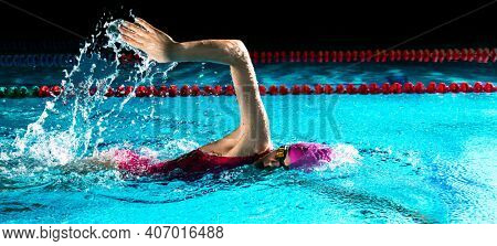 Professional woman in swimming pool. Crawl swimming style