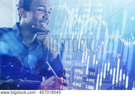 Smiling Afro-american Business Man Or Stock Trader Analyzing Stock Graph Chart By Fibonacci Indicato