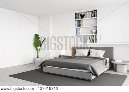 White And Grey Bedroom With Bed And Linens On Carpet And Bookshelf, Side View. Plant In The Corner,