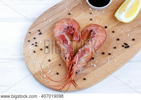 Two Red Shrimps In Heart Shape For Healthy Dinner For Valentine Day. Cooked Prawns With Salt And Lem