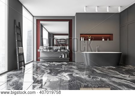 Dark Gray Bathroom Interior With A Marble Floor, Panoramic Windows, Grey Bathtub. Double Sink. Skysc