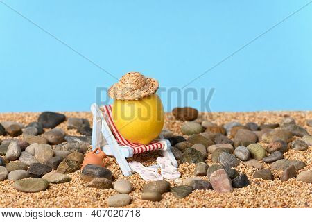 Conceptual Photo About A Holiday On A Pebble Beach On A Beautiful Sunny Day.