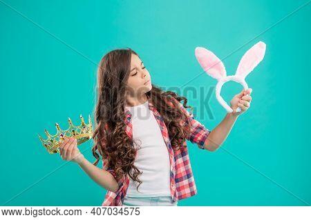 Child Choose Between Crown And Bunny Ears. Selfish Teenager Girl. Easter Bunny Hunt. Being Egoistic.