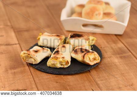 Appetizing Filled Bread Rolls On A Slate Plate.
