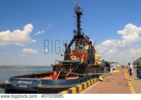 A Large Blue Tug, A Ship In A Sea, River Port, Moored Near The Pier. Tugboat Stands In The Seaport,