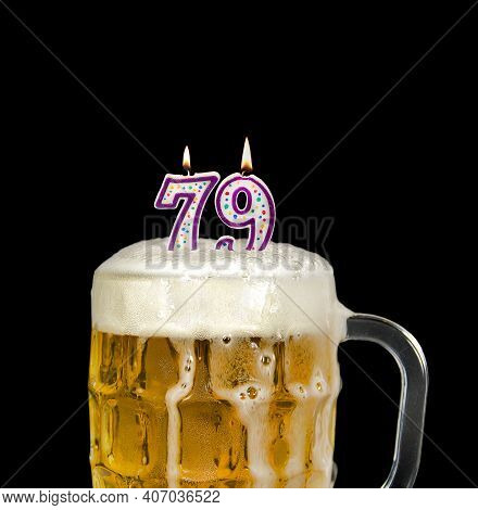 Number 79 Candle In Beer Mug For Birthday Celebration Isolated On Black