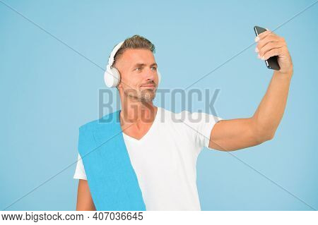 Selfie In Gym Concept. Sportsman Smartphone And Headphones. Healthy Lifestyle. Gym Aesthetics. Matur