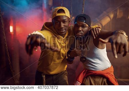 Two young rappers, breakdancing in studio