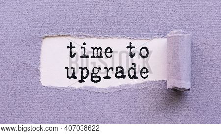The Text Time To Upgrade Appears On Torn Lilac Paper Against A White Background.