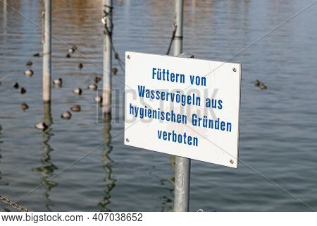 Prohibition Sign Feeding Forbidden, German Text Translation: Feeding Of Waterfowl Forbidden For Hygi