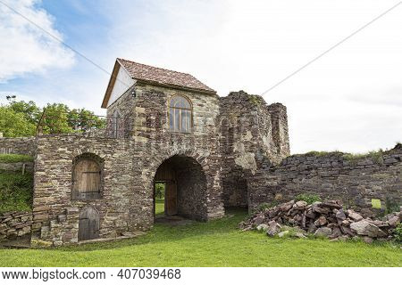 Scenic Ruins Of Medieval Castle Pidzamochok Among The Green Grass , Buchach Region, Ternopil Oblast,