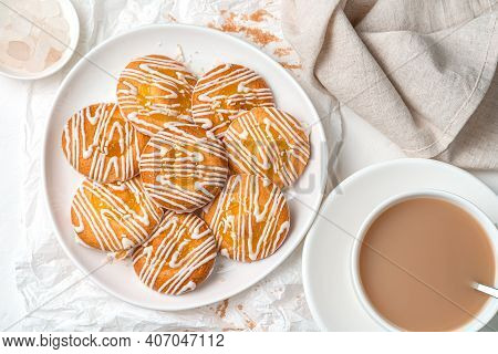 Sweet Cookies With Lemon Filling And White Chocolate On A Soft Light Background.