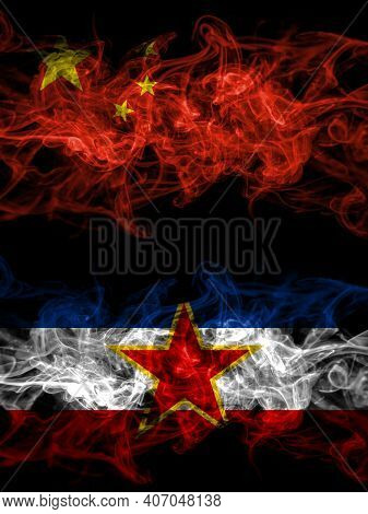 China, Chinese Vs Yugoslavia, Yugoslavian Smoky Mystic Flags Placed Side By Side. Thick Colored Silk