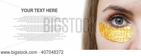 Close-up Of A Girl With Golden Patches Under Eyes. Mask For Skin Under The Eyes Against Wrinkles And