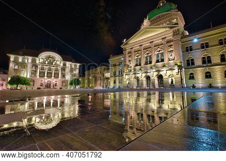 Federal Palace Facade In Bern, Switzerland And Swiss National Bank Illuminated At Night. Swiss Parli