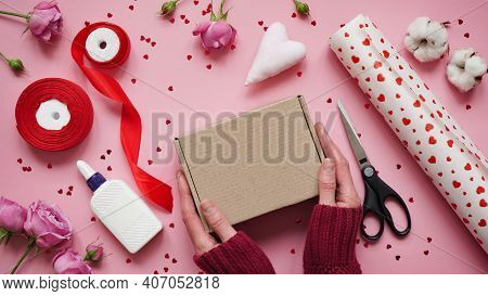 Step 2.step-by-step Instructions For Wrapping Gifts For Valentine's Day. Woman Wraps A Gift With Wra