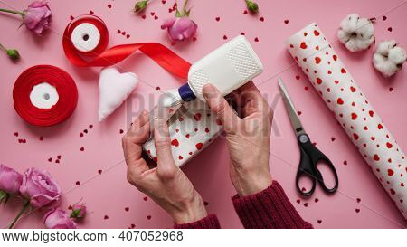 Step 8.step-by-step Instructions For Wrapping Gifts For Valentine's Day. Woman Wraps A Gift With Wra