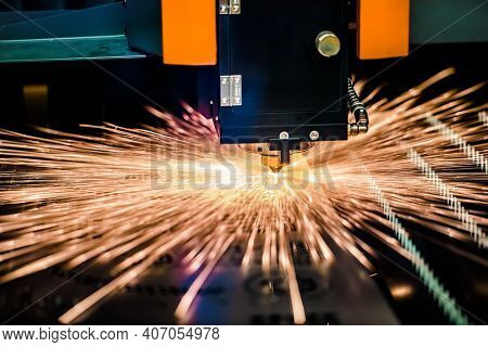 CNC Laser cutting of metal modern industrial technology. Laser cutting works by directing the output of a high-power laser through optics. Laser optics and CNC computer numerical control.
