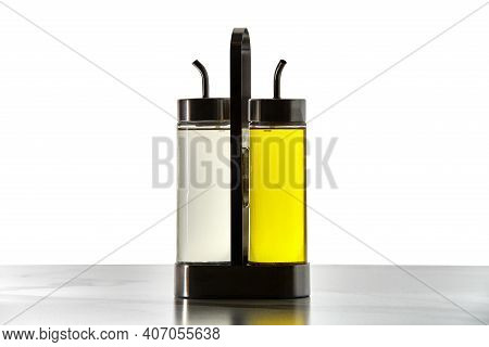 Flasks For Storing Cooking Oil Or Vinegar Are Placed In Metal Holder, Bottles Are Equipped With Fill