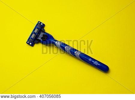 Gillette Uefa Razor. Shaver. Shave. Sharp Razor Blade. Yellow Background. 07.02.2021 Warsaw, Poland