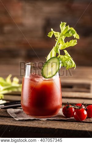 Classic Bloody Mary Or Virgin Mary Vodka Cocktail In A Cup With As A Hangover Drink In A Rustic Envr