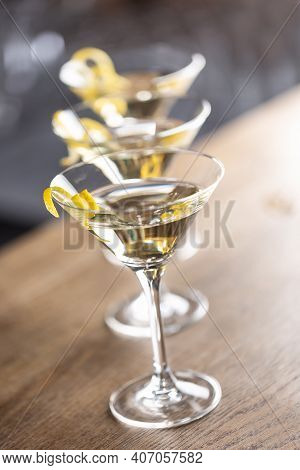 Dry Martini Short Drink Cocktail With Gin, Dry Vermouth And A Lemon Zest Garnish