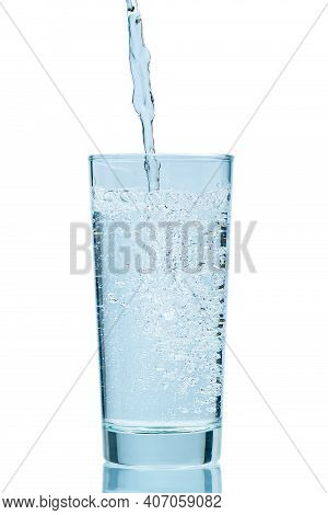 Pouring Water. Pouring Fresh Clean Drinking Water To Glass. Isolated On White