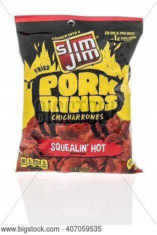 Winneconne, Wi -6 February 2021: A Package Of Slim Jim Pork Rinds On An Isolated Background.