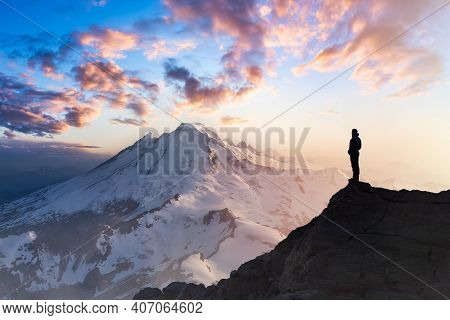 Adventure, Explore And Lifestyle Concept Composite. Adventurous Man Hiker On Top Of A Steep Rocky Cl