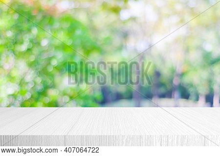 White Wood Table, Counter Background, White Wooden Shelf And Blur Green Tree Nature For Food Picnic,