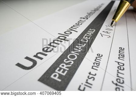 Completing Unemployment Benefits Application Form With Placeholder Name, Shot With Macro Probe Lens