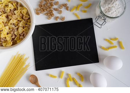 Assorted Italian Pasta. On A White Background. View From Above. Pasta On A Plate. Flour, Eggs And Pa