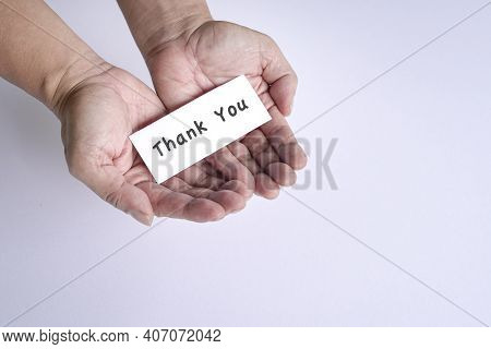 Thank You Note On The Open Palm Of Man's Hands. A Gesture Of Appreciation.