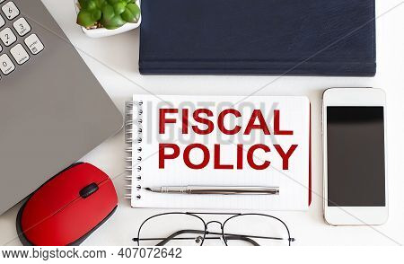 Fiscal Policy Text On The Notepad,pen, Office Tools On The White Background. Business