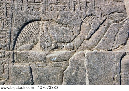 Carving Of The Ibis-headed God Thoth, An Ancient Egyptian Deity. Carving On A Wall Of The Temple Of