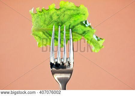 Diet, Vegan Or Vegetarian Food (green Lettuce Leaf) On Fork. Healthy Eating Diet Concept For Weightl