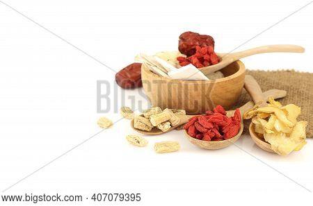 Many Chinese Medicine Herbs ,goji Berry, Dried Jujube, Chinese Yam, Polygonatum  In Wooden Bowl