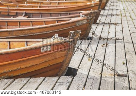 Bled, Slovenia, October 2020: Boats With Manufacturer's Signs Are Moored By A Chain On Lake Blaysko