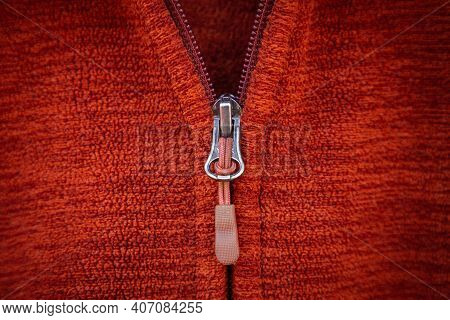 Zip On Red Clothes Background. Zip For Design. Zip Close Up Macro. Zip On A Red Fabric Base. Zip Des