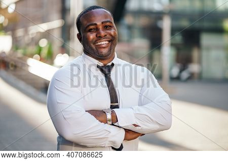 Portrait Of Happy African-american Businessman Who Is Looking At Camera And Smiling.
