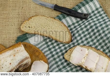 Traditional Ukrainian Food. Salted Lard, A Sandwich And An Old Knife On Sackcloth. Ready To Eat Salt