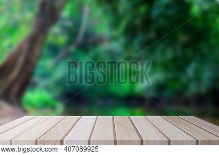 Empty Wood Table Shelf And Blurred Garden Cafe Nature Background. Product Display Template. Business