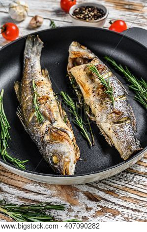 Baked Sea Bass Fish, Grilled Seabass. White Wooden Background. Top View