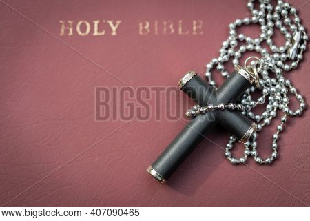 Closeup Of Simple Christian Cross Necklace On Bible. Concept For Christian, Christianity, Catholic R