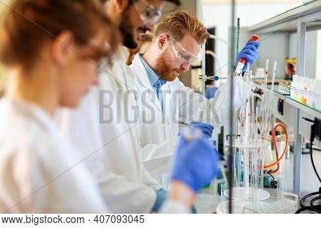 Group Of Medical Scientists Working At The Laboratory. Research Virus People Concept