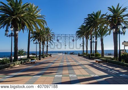 Famous Place To Visit In Nerja, Spain. Viewpoint Called Balcony Of Europe (balcón De Europa). Palm T