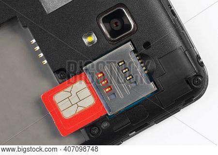 Sim Card Slot, Sim Card, Camera And Mobile Phone Light. Close-up.