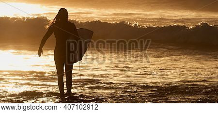 Silhouette Surfer Girl Surfing Looking At Ocean Beach Sunset