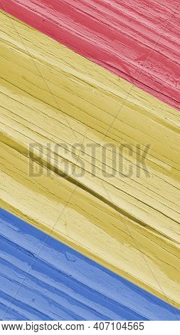 The Flag Of Romania On Dry Wooden Surface, Cracked With Age. Pale Faded Paint. Vertical Mobile Phone